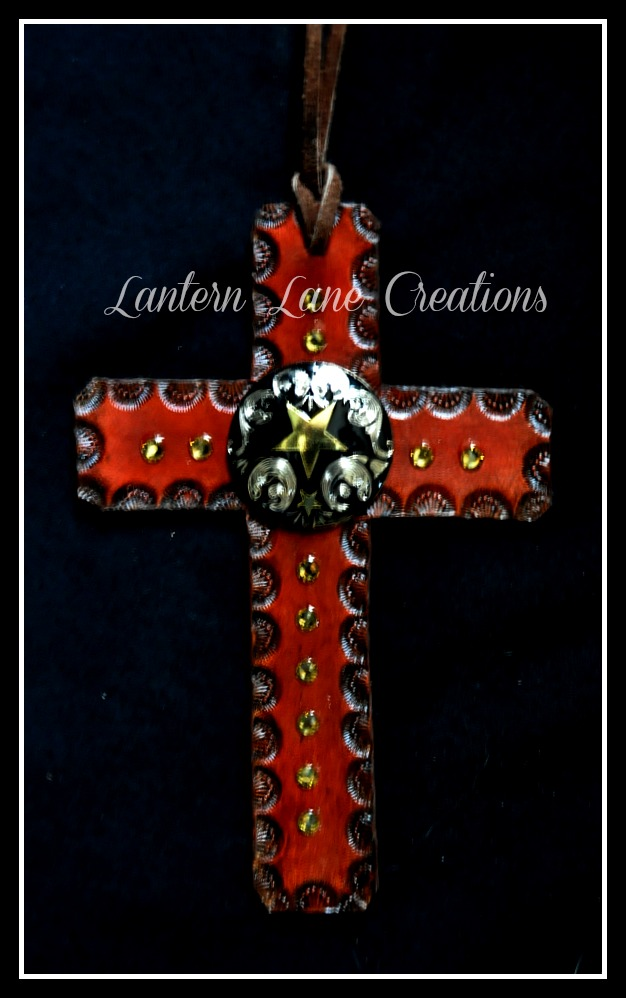 Saddle Cross With Black Conchos And Gold Stars By Lantern