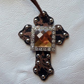 sold-custom-saddle-cross